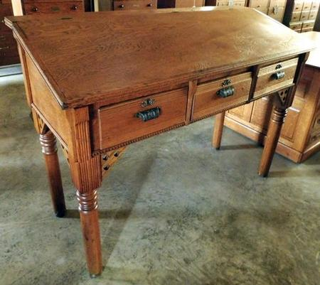 Oak Eastlake style stand-up writing desk with lift lid storage. 3 drawers  with original Eastlake style cast iron pulls. Turned legs. - Smith's Antiques - #D327 Oak Eastlake Stand Up Desk - Smith's
